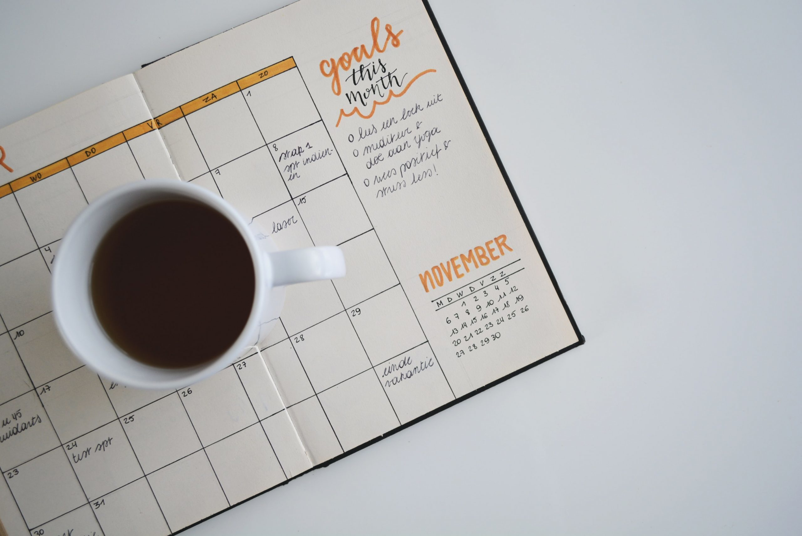photo of calendar and coffee